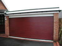 Garage doors roller sectional up and over auto security for Garage screen door rollers